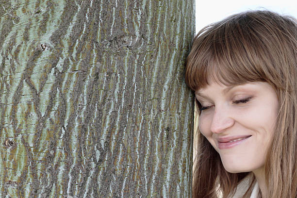 smiling latvian tree girl next to red snakebark maple - whiteway latvian outdoor girl stock photos and pictures