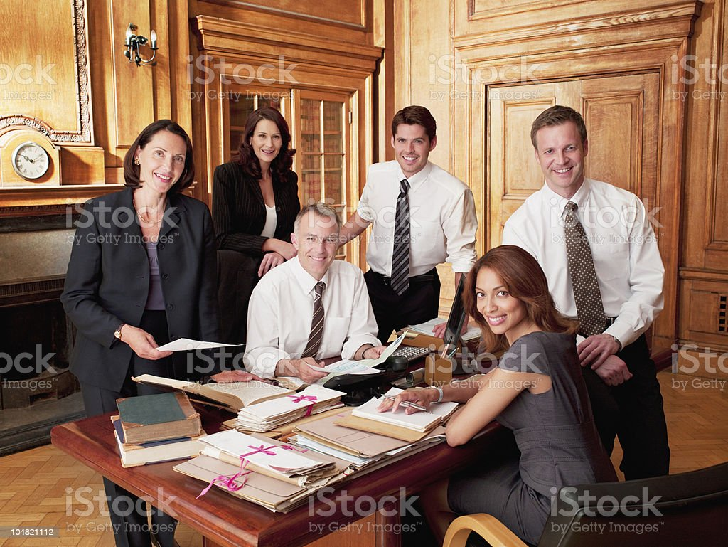Smiling lawyers in office stock photo
