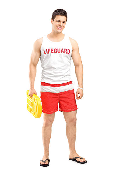 Smiling lifeguard on duty posing Full length portrait of a smiling lifeguard on duty posing isolated on white background lifeguard stock pictures, royalty-free photos & images