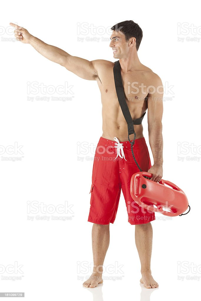 Smiling lifeguard pointing royalty-free stock photo