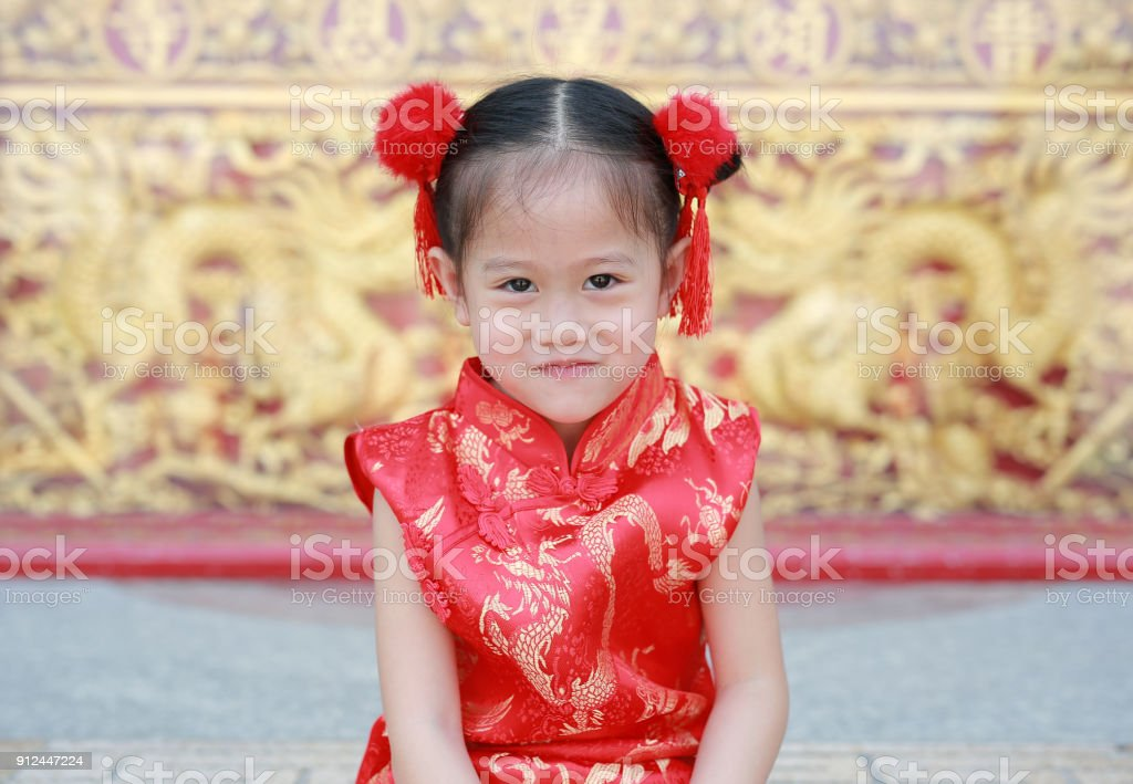 83e3514c5 Smiling little asian girl in cheongsam on traditional chinese new year  festival. royalty-free