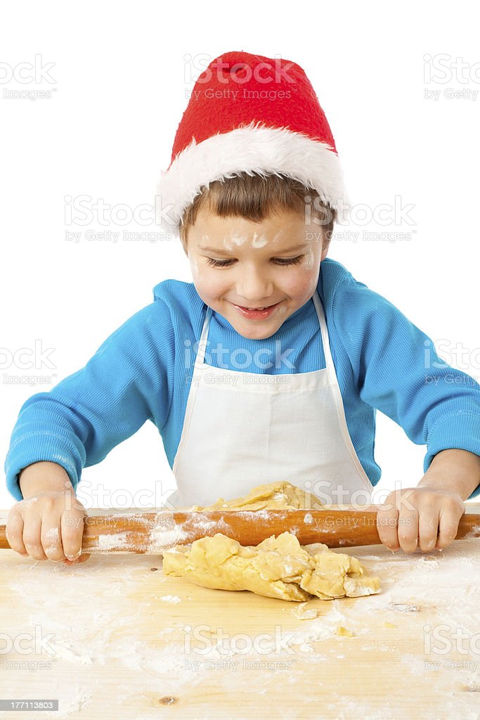 Smiling little bot kneading for Christmas cooking royalty-free stock photo