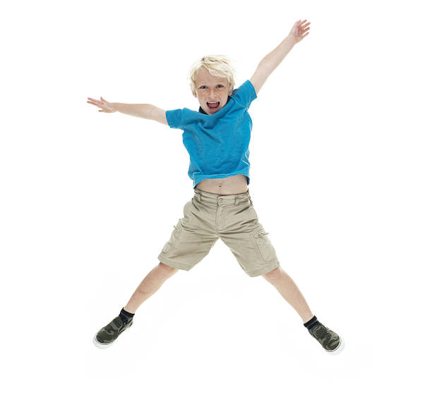 Smiling little boy jumping and cheering stock photo