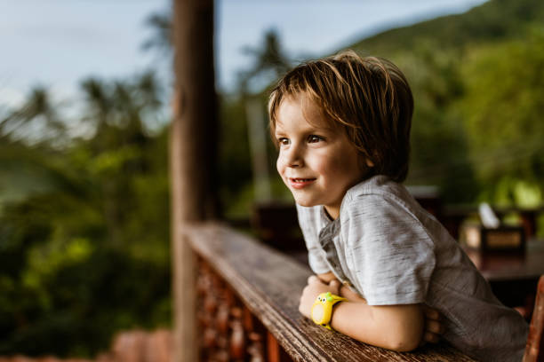 Smiling little boy on a terrace. stock photo