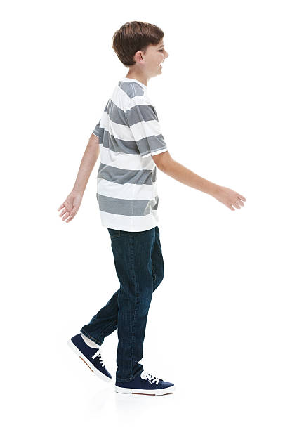 Smiling little boy walking stock photo