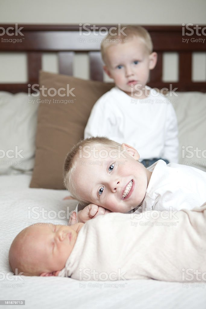 Smiling Little Boy with Baby Sister and Brother royalty-free stock photo