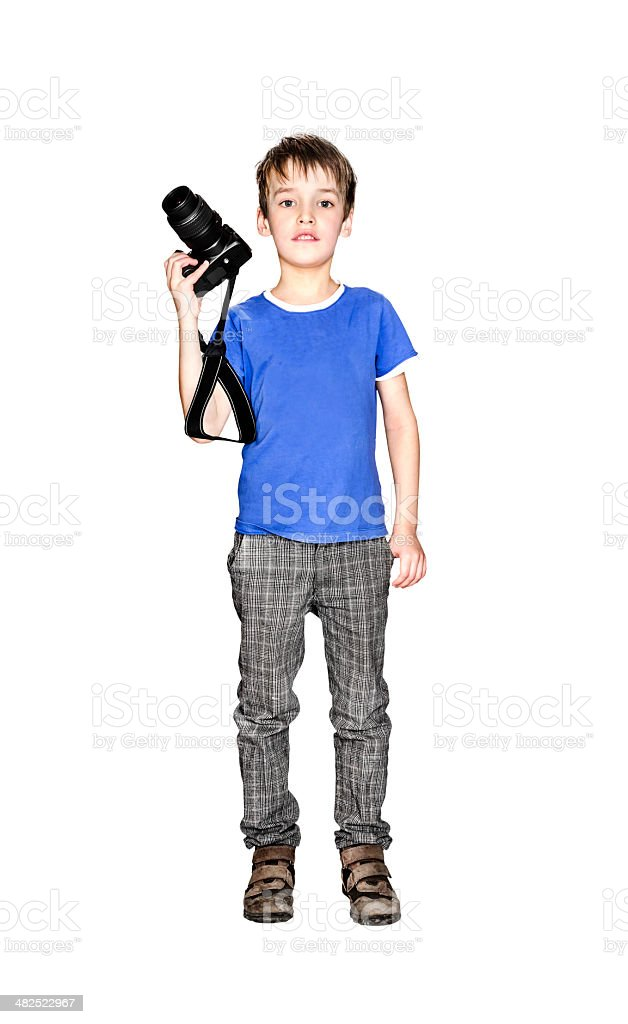 Smiling little boy with camera stock photo