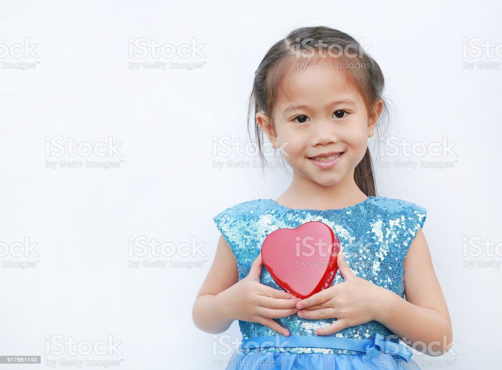 b62435050 Smiling little child girl with holding red heart isolated on white  background. Concept Valentine's Day