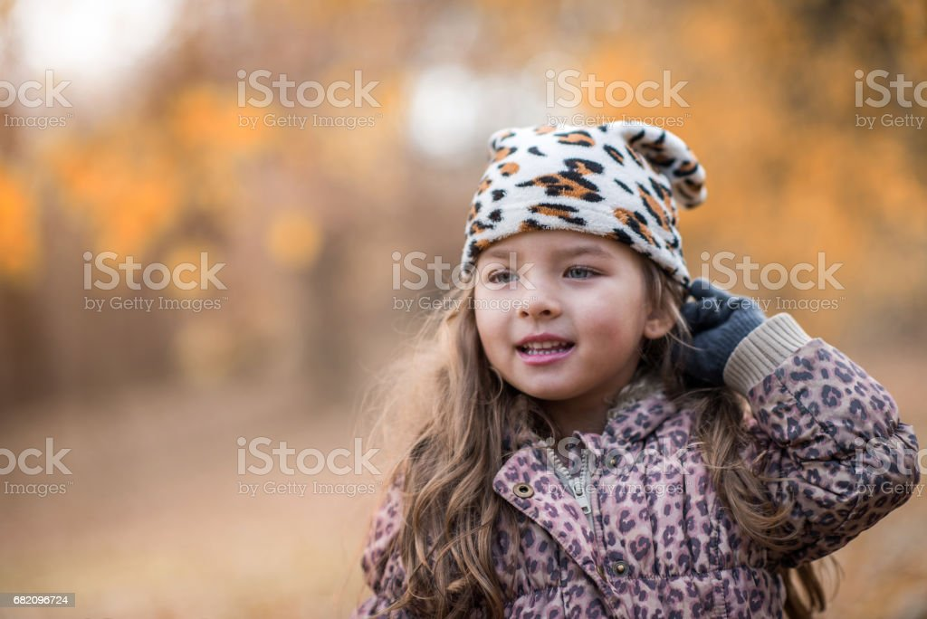 Smiling little girl enjoying a day in nature. stock photo