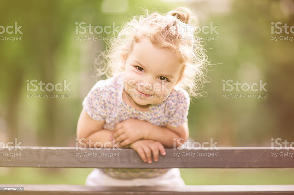 Smiling Little Girl Enjoying Her Time in the Park stock photo