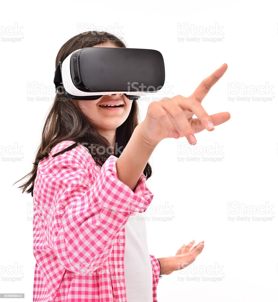 Smiling little girl experience with VR headset - Photo