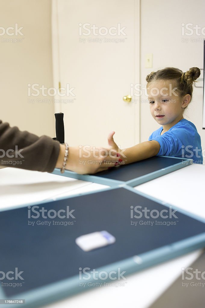 Smiling Little Girl  Getting X-Ray Taken (Series) stock photo