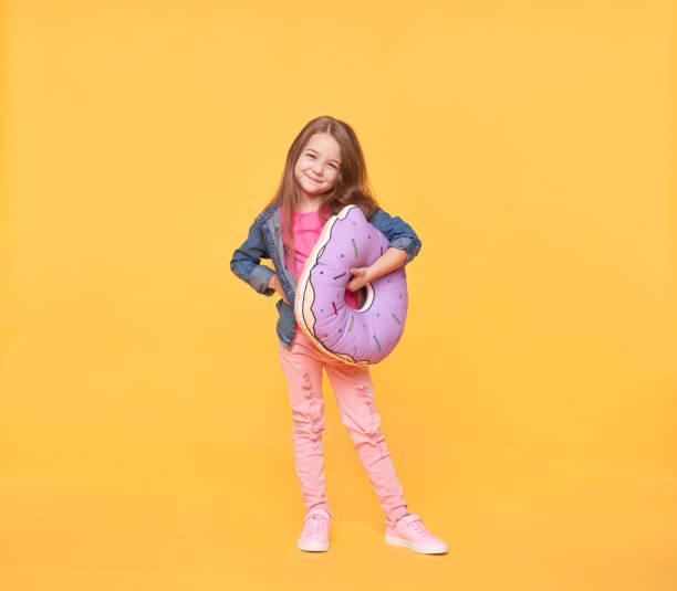 Smiling little girl holding a giant donut pillow picture id638626022?b=1&k=6&m=638626022&s=612x612&w=0&h=hmtjgciecw4ykxrsfzosuonv7sfbzm8lw5pqvlaxh2m=