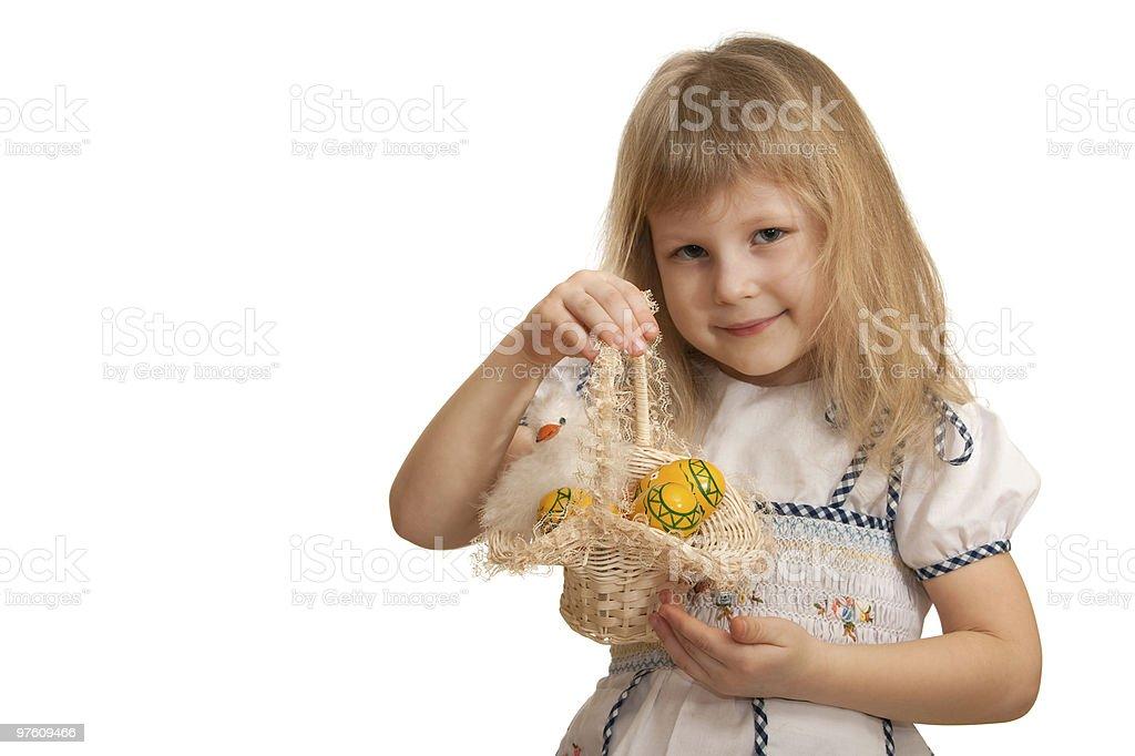 Smiling little girl holding Easter basket royaltyfri bildbanksbilder