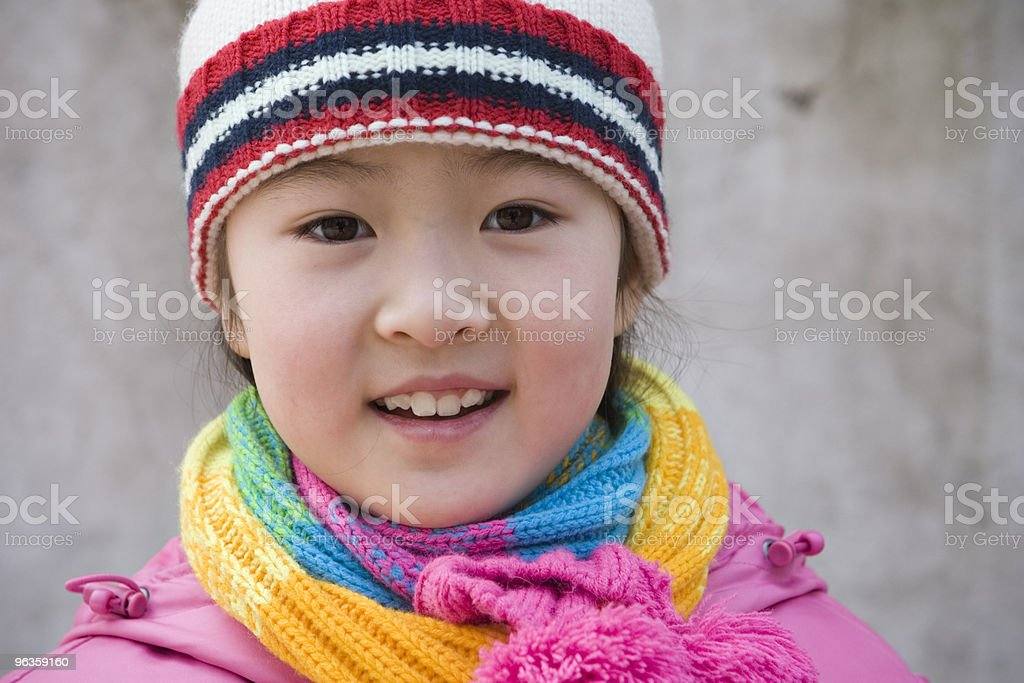 smiling little girl in colorful winter outfits royalty-free stock photo