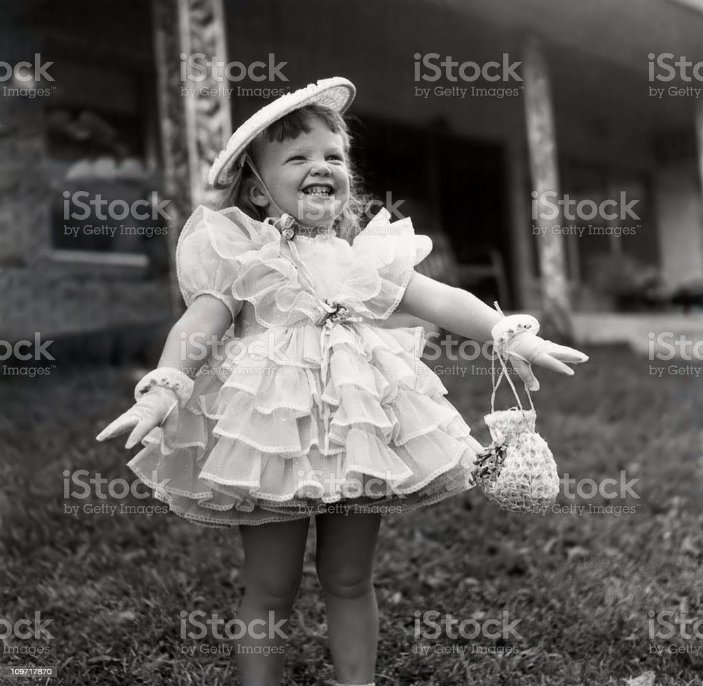 Smiling Little Girl in Fancy Ruffle Dress stock photo