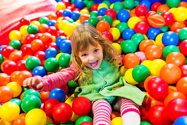 Smiling little girl in playroom. stock photo