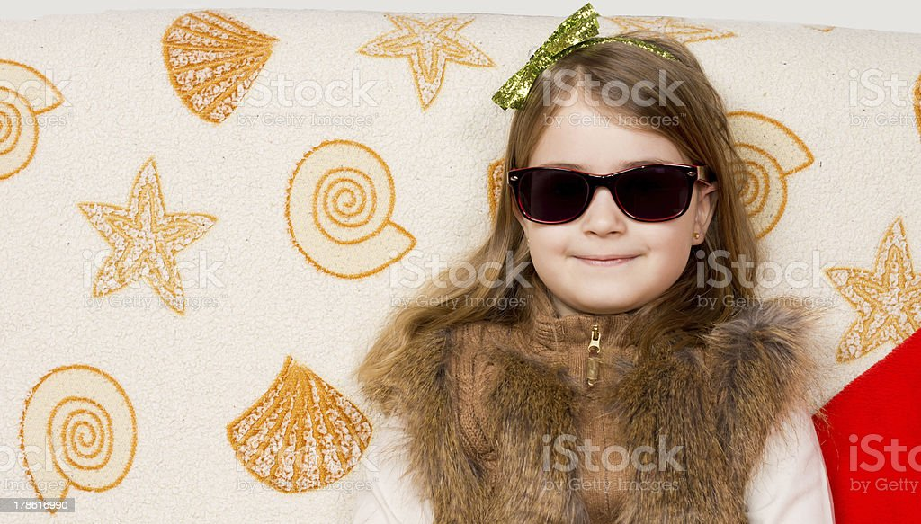 Smiling little girl in sunglasses royalty-free stock photo