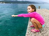 Smiling Little Girl on a Pier.