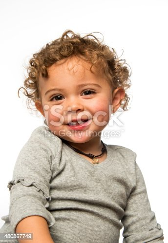 Two years old caucasian little girl posing on white background smiling