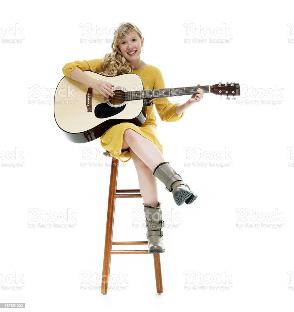 Smiling little girl playing guitar stock photo