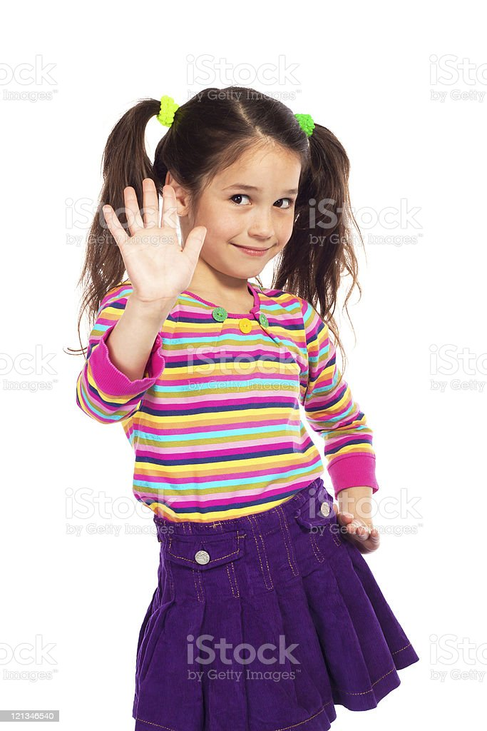 Smiling little girl showing her hand up royalty-free stock photo
