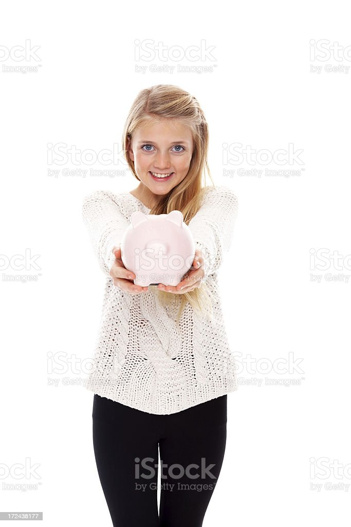 Smiling little girl showing you a piggy bank royalty-free stock photo
