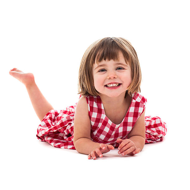 Smiling little girl wear red chequered dress stock photo