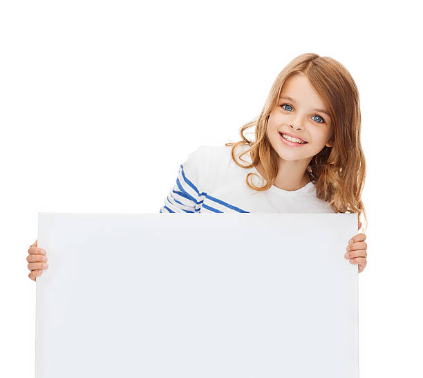 smiling little girl with blank white board stock photo