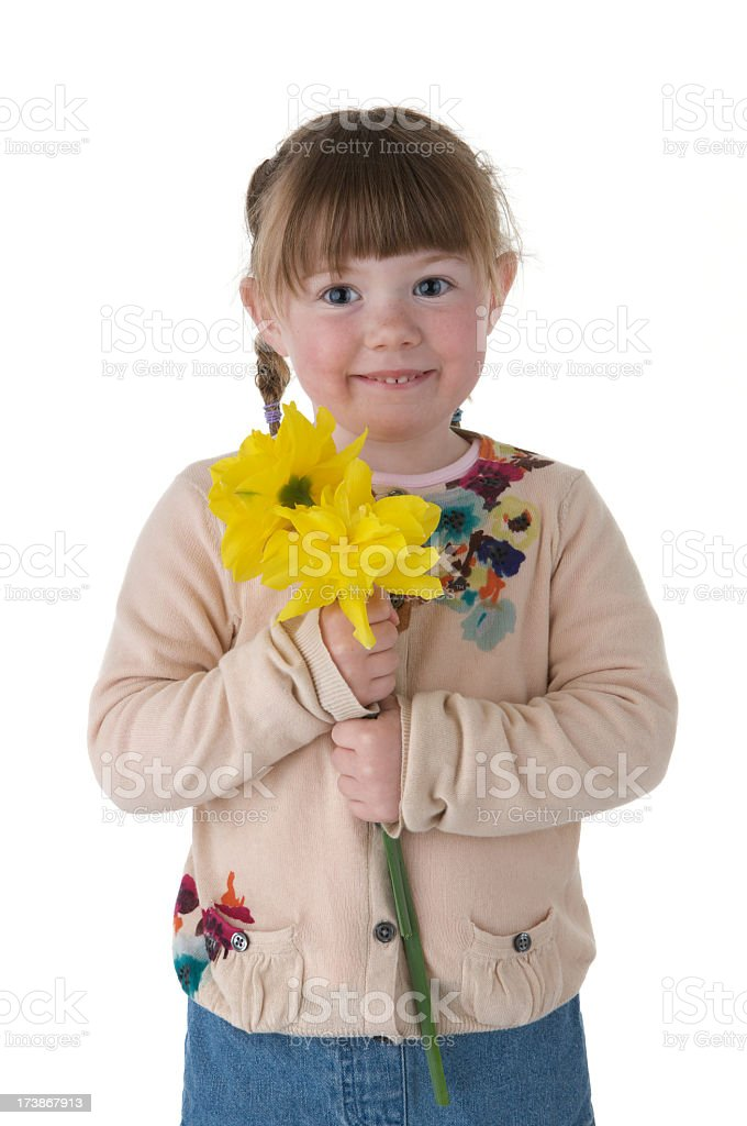Smiling little girl with bunch of Daffodils on white background royalty-free stock photo