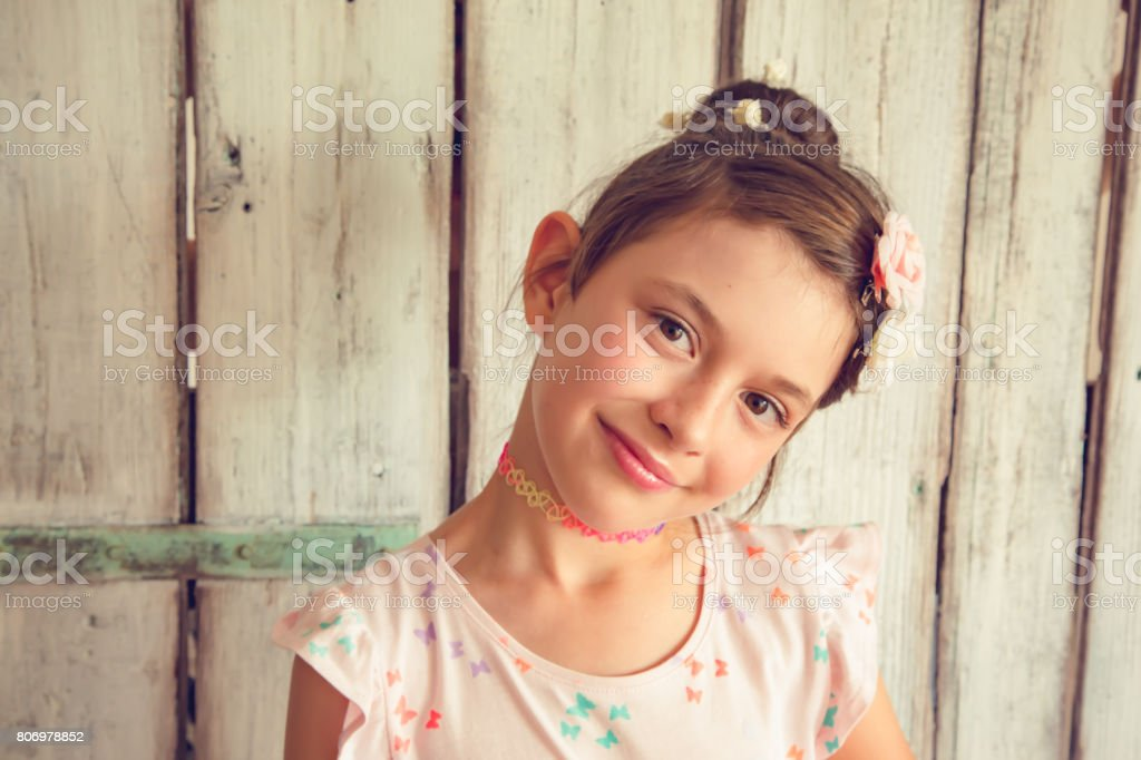 Smiling little girl with flowers stock photo