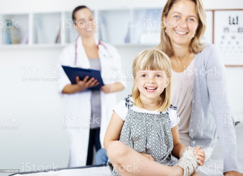 Smiling, little girl with mother royalty-free stock photo