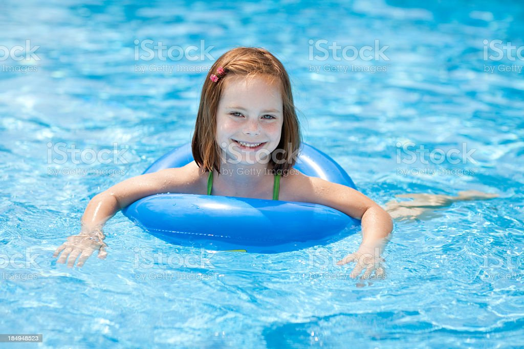 Smiling, Little Girl With Swim Ring, in Swimming Pool stock photo