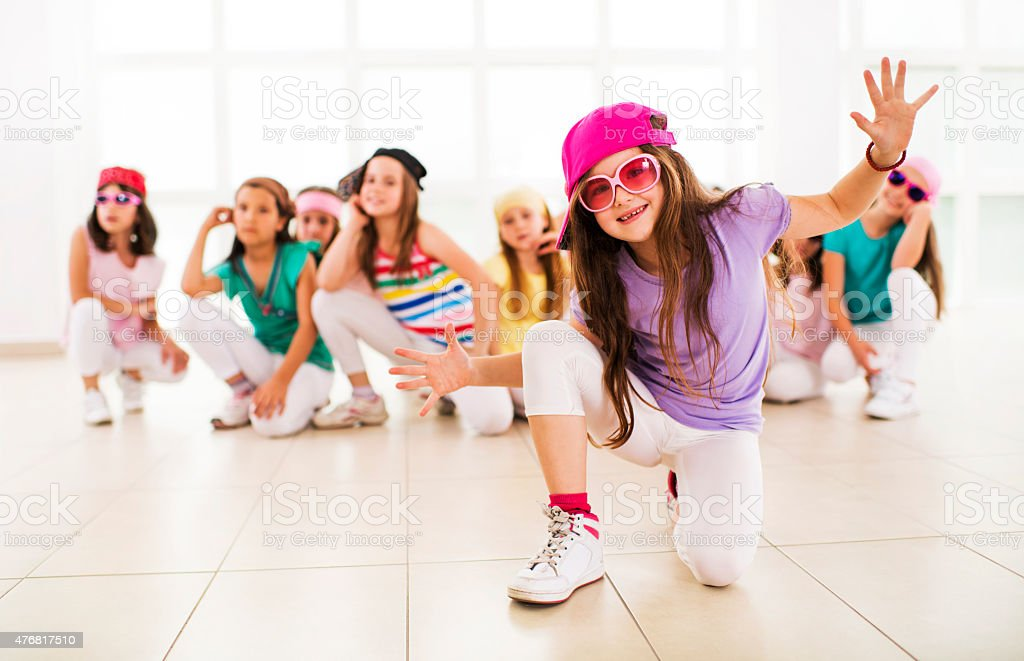Smiling little hip hop dancer looking at the camera. stock photo
