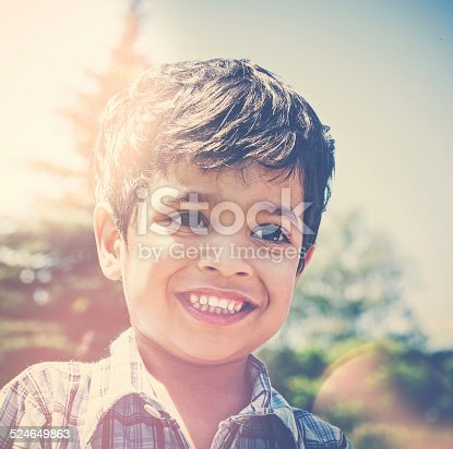 941782244 istock photo Smiling Little Indian Preschool Boy Outdoors 524649863