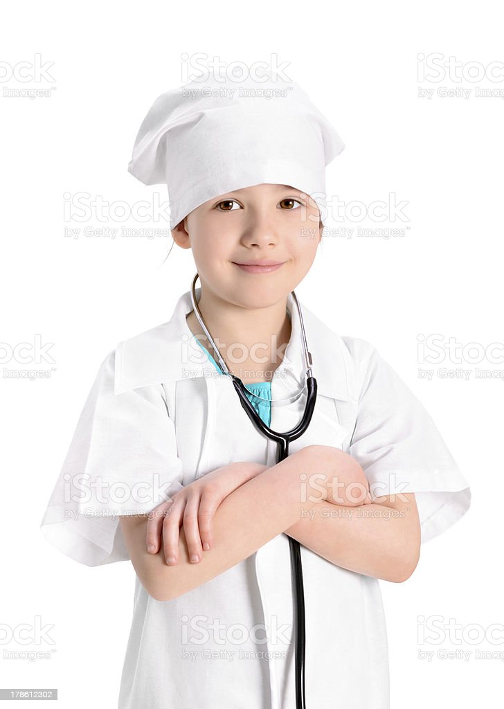 Smiling little nurse with hands crossed royalty-free stock photo
