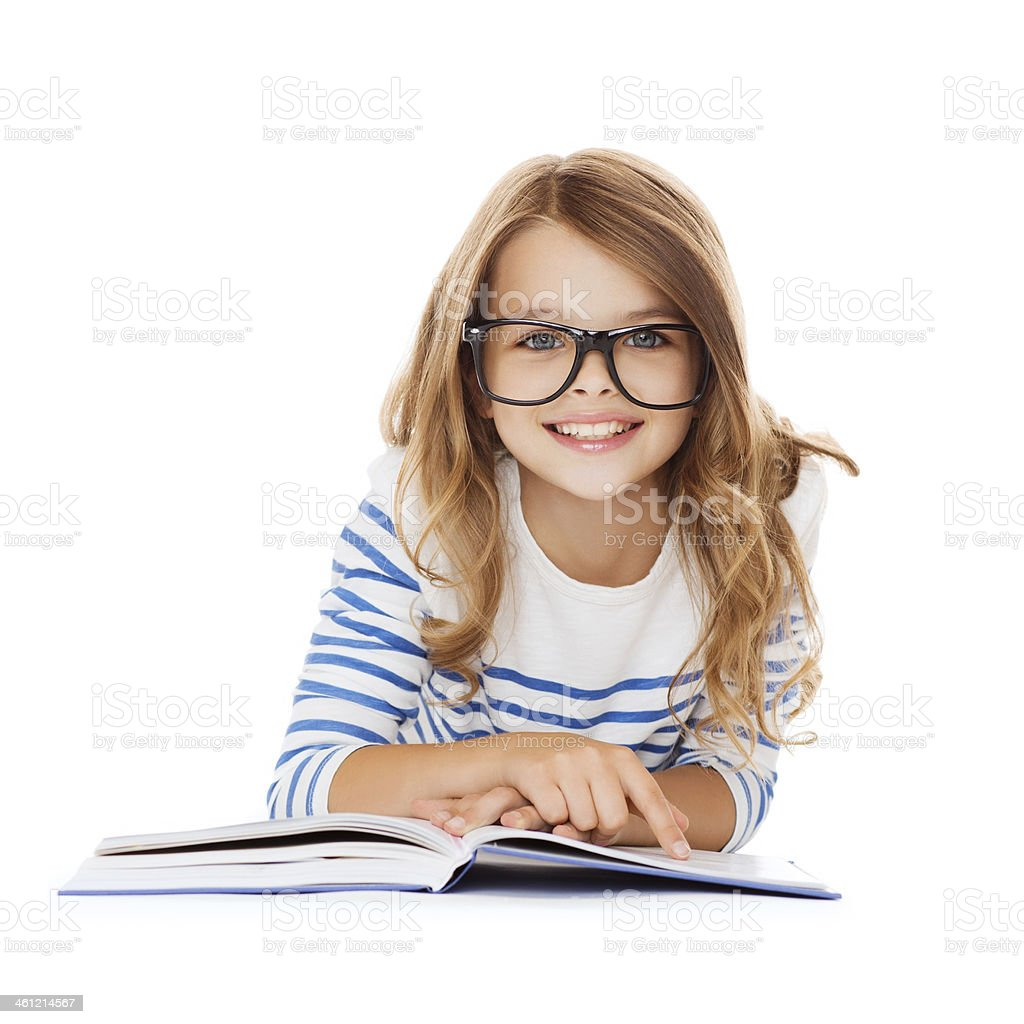 smiling little schoolgirl in glasses with book stock photo