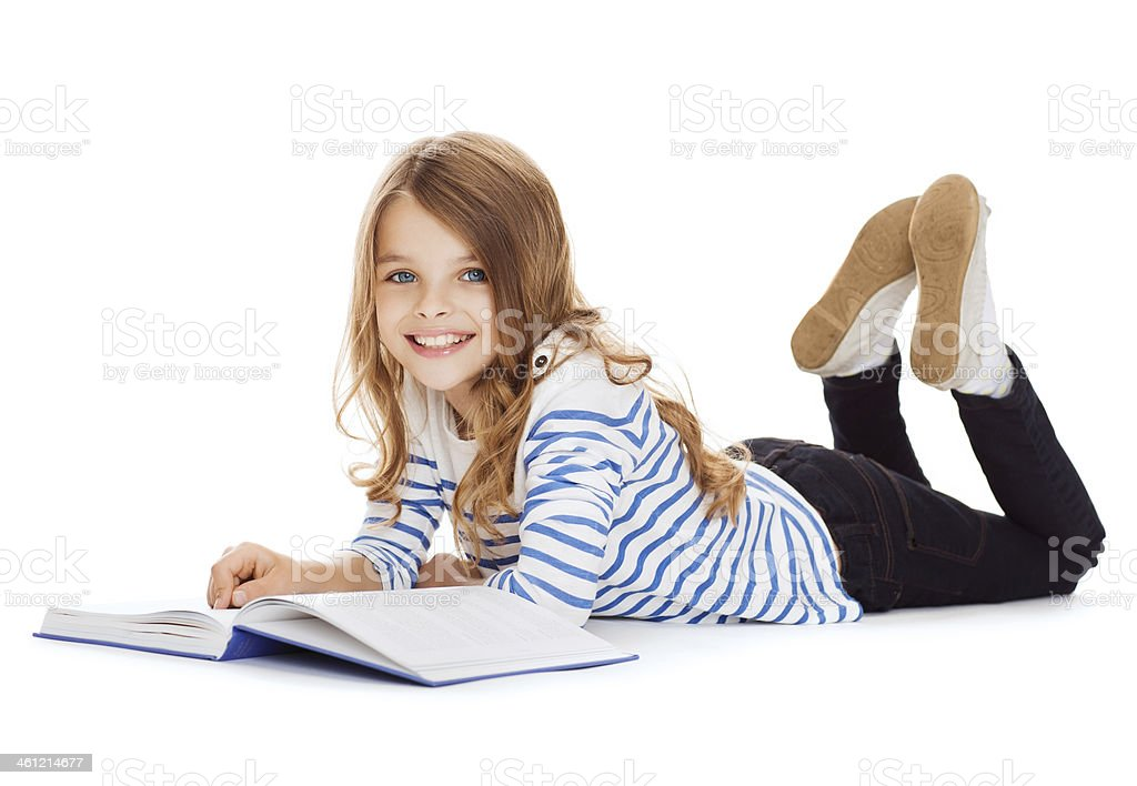 smiling little student girl lying on the floor stock photo