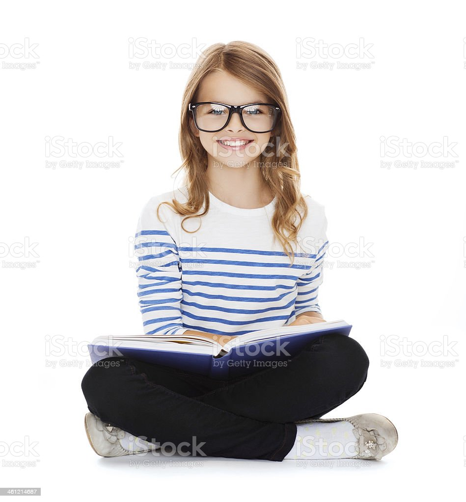 smiling little student girl sitting on the floor stock photo