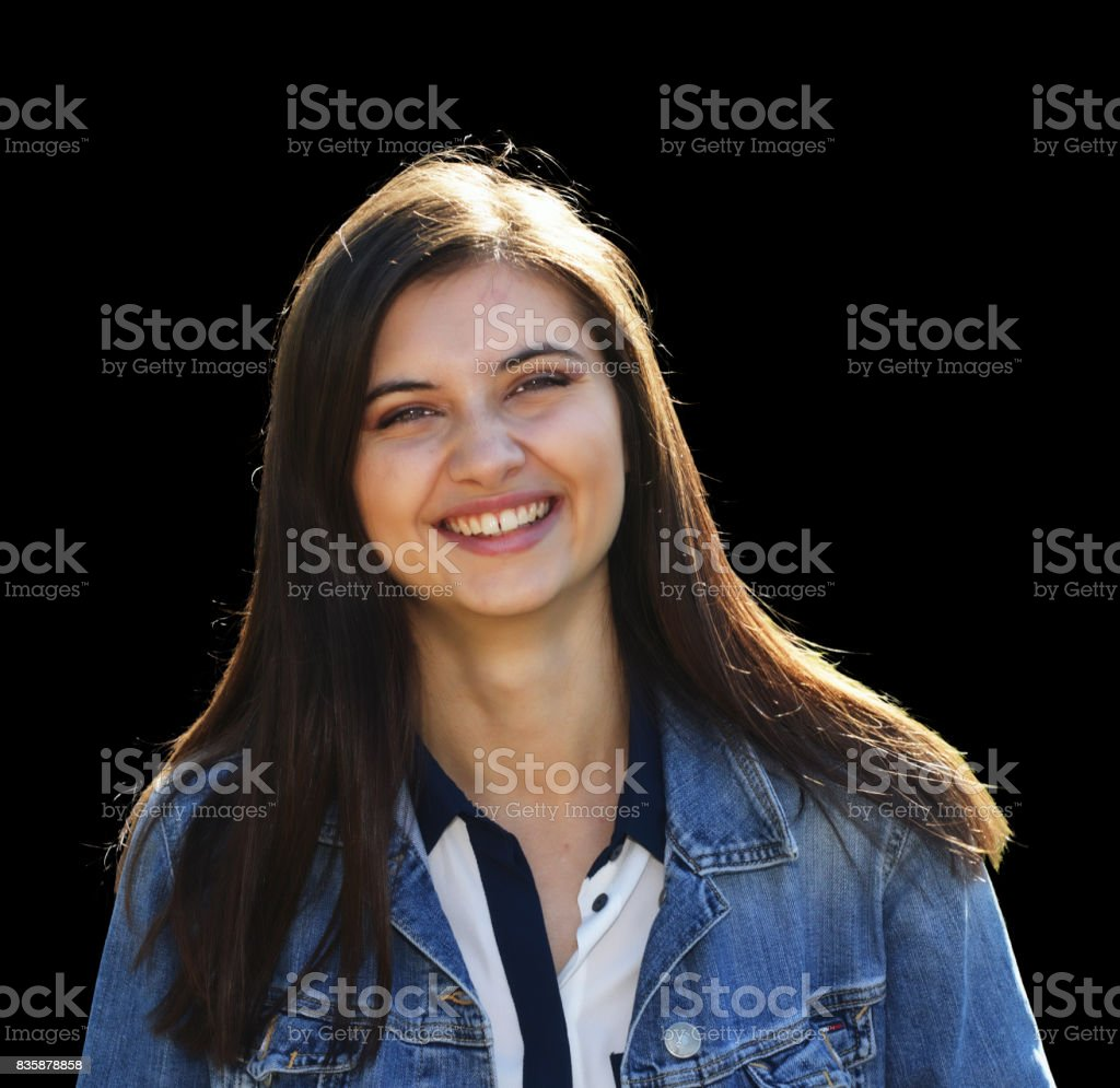 Smiling long haired 2017 teenager Bulgarian outdoor girl head and shoulders stock photo