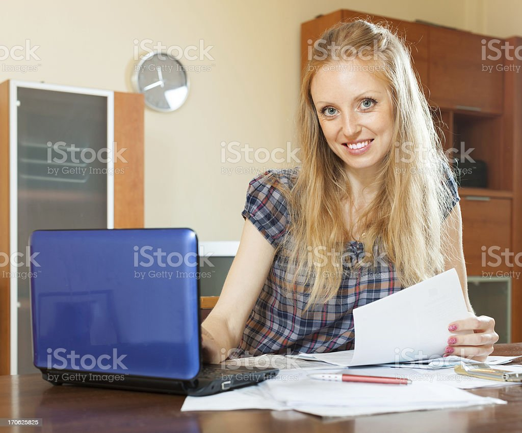smiling long-haired woman  with  documents royalty-free stock photo
