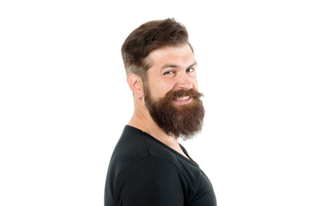 Smiling macho. Barber shop concept. Man bearded hipster with mustache. Beard mustache grooming guide. Hipster handsome bearded guy white background. Growing and maintaining moustache. Grow mustache stock photo