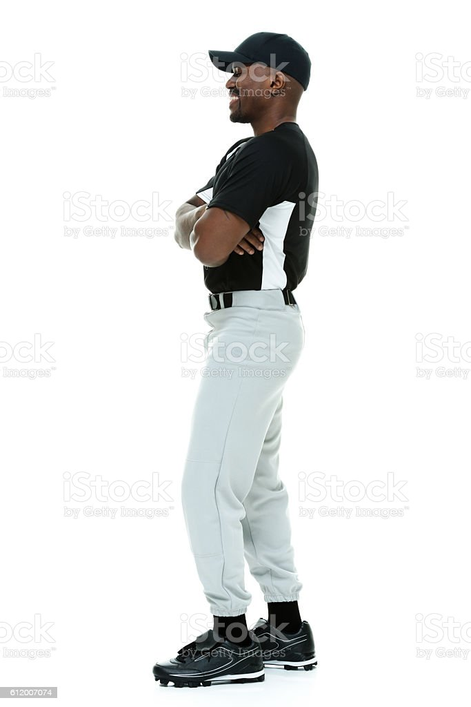 Smiling male athlete standing stock photo