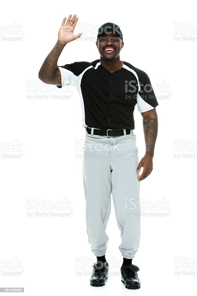 Smiling male athlete waving hand stock photo