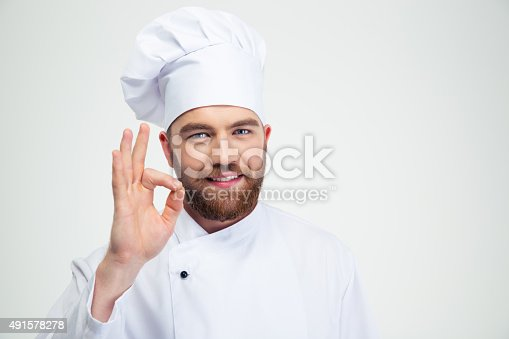 istock Smiling male chef cook showing ok sign 491578278