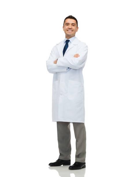 smiling male doctor in white coat stock photo
