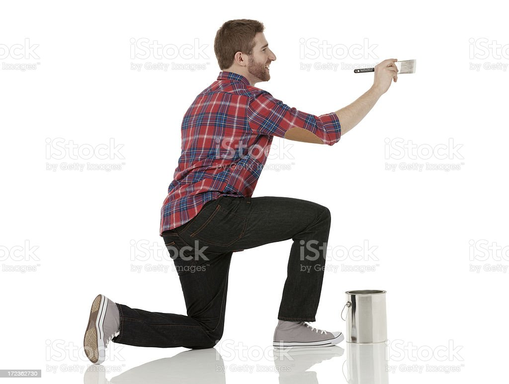 Smiling male painter painting a wall stock photo