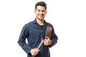 istock Smiling Male Repairman Holding Wrench And Clipboard 1048532232