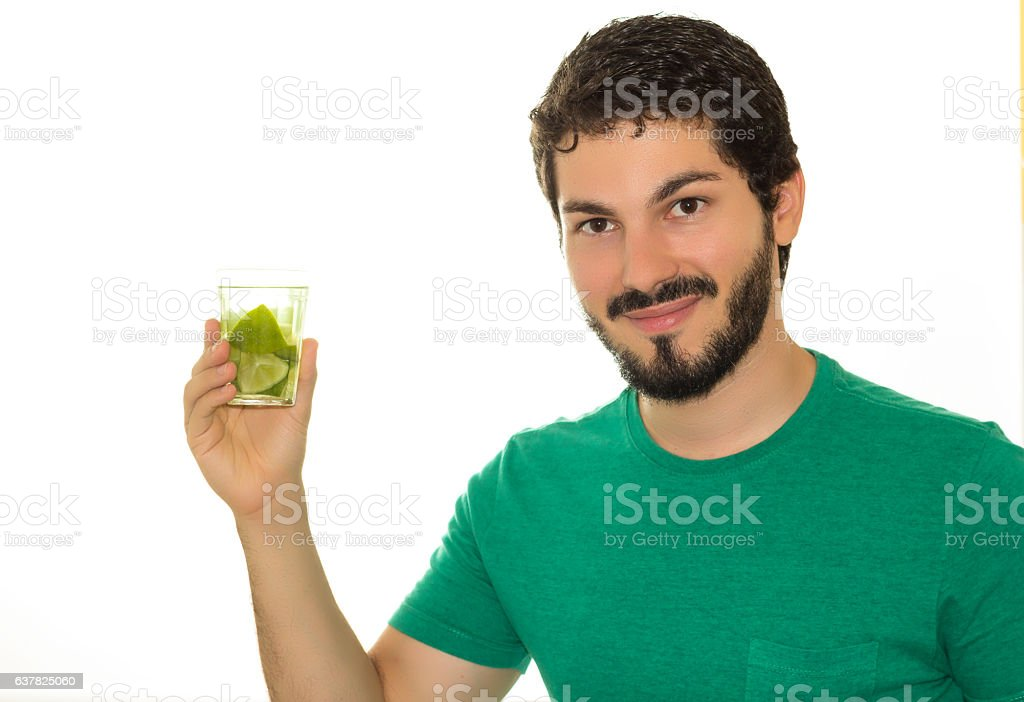 Smiling male shows drinking glass. stock photo