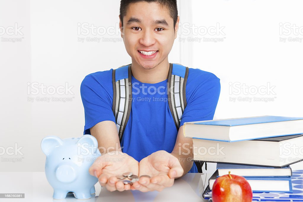 Smiling male student with coins in palm stock photo